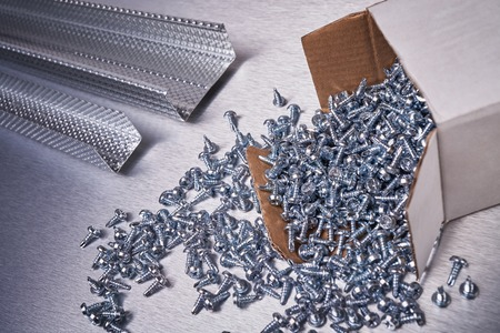 Profile for plasterboard, placer screws for construction, building materials, steel profiles for repair, construction works Stock Photo