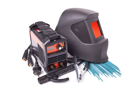 Inverter welding machine, welding equipment isolated on a white background, welding mask, set of accessories for arc welding Stock Photo