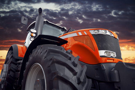 technologically: Tractor working on the farm, a modern agricultural transport, a farmer working in the field, tractor at sunset, modern tractor closeup