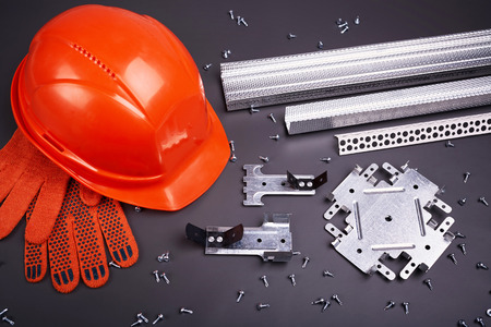 building materials: Construction helmet, profile for plasterboard, fixing plasterboard, set of building profiles, building materials, steel profiles for repair, construction works, personal protective equipment