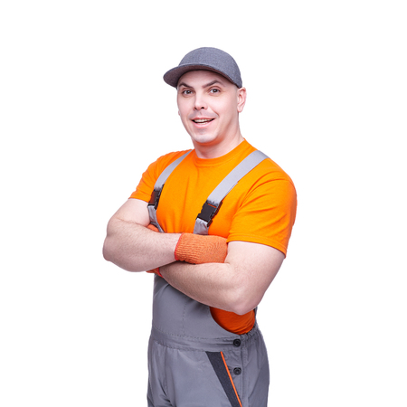 Loader in workwear, profession of the service industry, young sports man, cargo transportation, courier in working clothes, worker isolated on white background