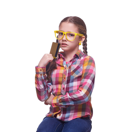 Teenager with a credit card, cash savings, shopping and spending, childrens emotions, girl with glasses, home clothes, portrait of a young girl, isolated on white background