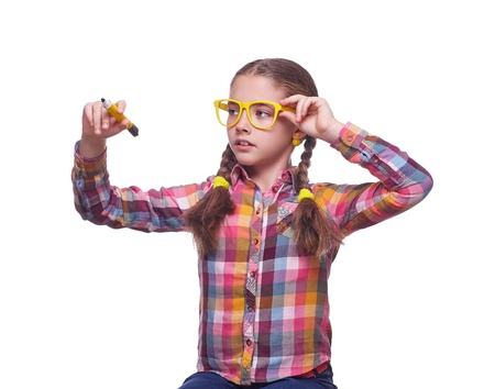 Teenager with a marker, a girl writes, childrens emotions, schoolgirl doing homework, girl with glasses, home clothes, portrait of a young girl, isolated on white background
