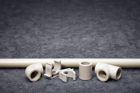 Plastic water pipes, components for conducting water pipes, autonomous heating, textured background, accessories for construction works, plastic water supply units, heating systems. Standard-Bild - 127274069
