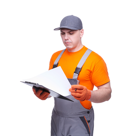 Loader in workwear, profession of the service industry, paper tablet, writing documents, young sports man, cargo transportation, courier in working clothes, worker isolated on white background