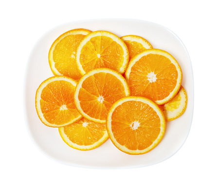 orange slices on a white plate photo