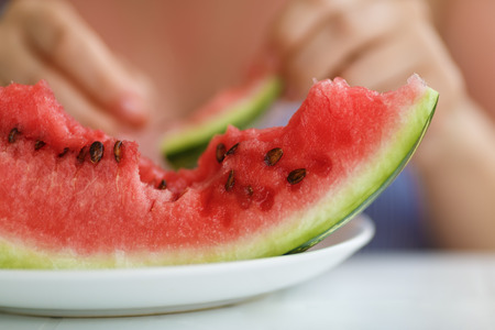 A piece of delicious juicy watermelon. Shallow depth of field.