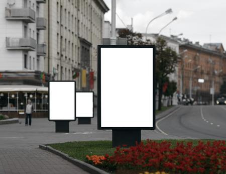 billboard: Three Blank Billboards on City Street . Clipping path.  Shallow depth of field.