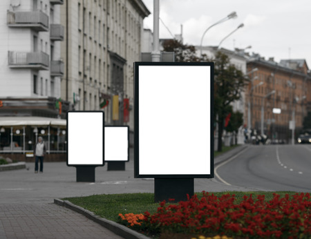 Three Blank Billboards on City Street . Clipping path.  Shallow depth of field.