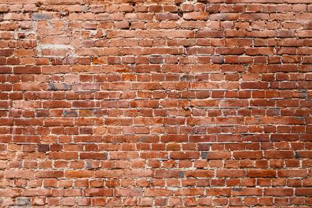 古いレンガの壁。古いれんが造りの壁のテクスチャ。