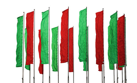 flagpoles: Several flagpoles with vertical green and red flags