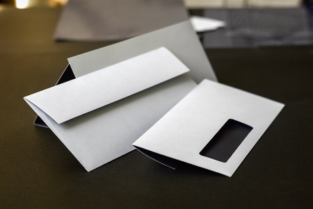 Modern envelopes with a window. Shallow depth of field. Standard-Bild