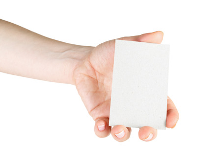 Blank business card in hand. For design presentations and portfolios. Isolated on white. Clipping path. photo