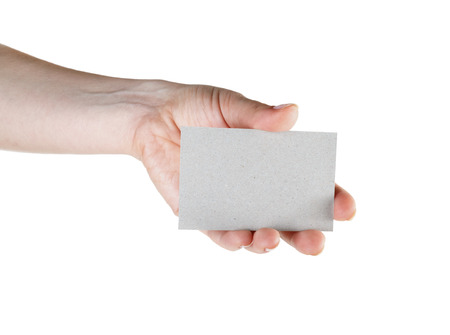Blank business card in hand isolated on white background.  photo