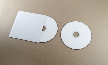 business invitation: Blank compact disk on a table. Mock-up for branding identity for designers.