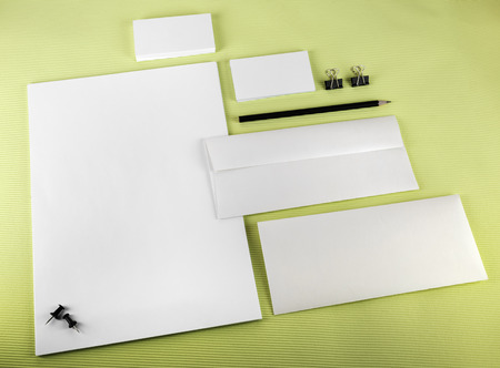 office paper: Corporate identity set on green background. Blank stationery.