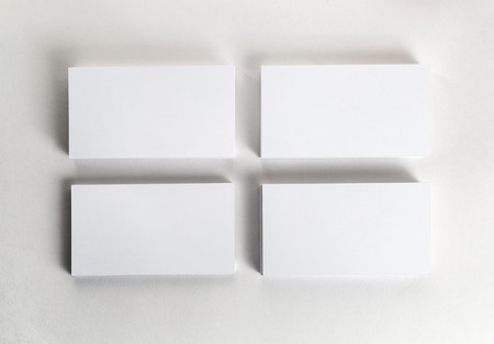 business cards background: Blank business cards on the table. Template for ID. Top view.