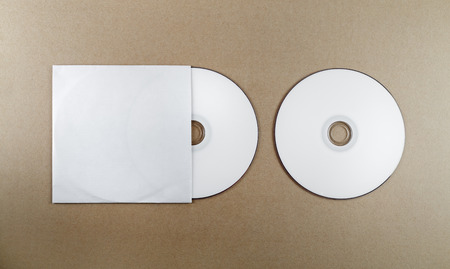 for designers: Blank compact disk on a table. Template for branding identity for designers. Top view.
