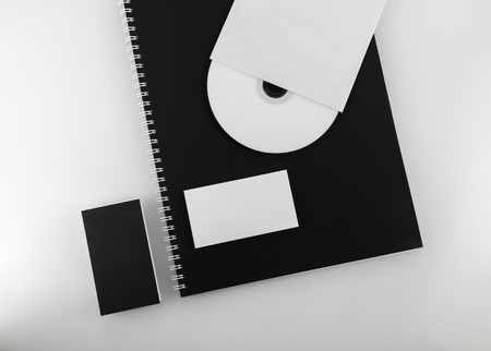 for designers: Blank business cards, compact disc and notepad. Template for branding identity for designers. Top view.