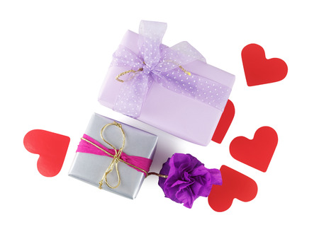 Bright multi-colored gift boxes with paper hearts on a white background. Isolated with clipping path. Top view. photo