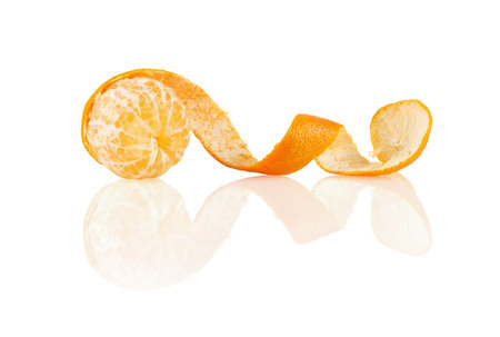 Peeled mandarin on a white background with reflection. Isolated with clipping path. photo