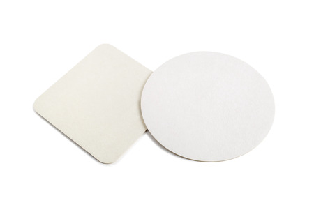 Blank cardboard coasters for beer on a white background. Round and square.