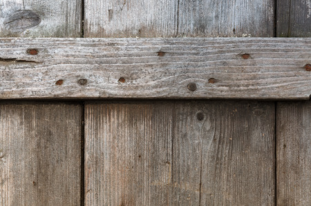 weather front: Old weathered textured wooden planks from the weather. Front view. Stock Photo