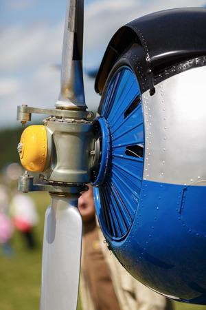 Propeller aircraft closeup. Shallow depth of field. Vertical shot. photo