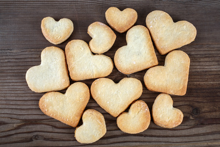 small tree: Heart shaped cookies on wooden background. Top view.