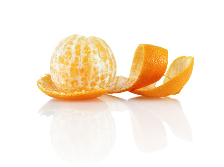 Delicious sweet juicy clementine. Peeled mandarin and peel on a white background with reflection. Isolated on white background. photo