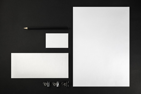 Blank stationery and corporate identity template on dark background.  For design presentations and portfolios. Top view.