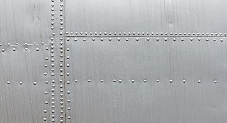 リベットで銀の金属の質感。抽象は、メタリックな背景を風化させた。