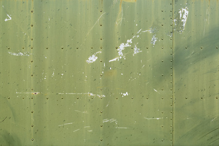 Abstract painted green metal plates background texture with seams and rivets. Standard-Bild