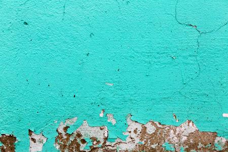 청록색 질감입니다. 페인트 배경 껍질. 오래 된 벽의 조각, 시간이 지남에 따라 금, 밝은 청록색 페인트를 그렸다.