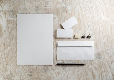 stationery set: Blank stationery set on light wooden background. Template for ID.