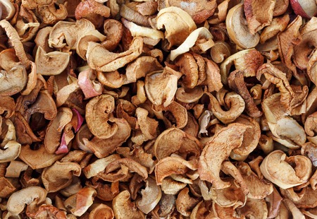 dried fruit: A lot of dried fruit. Dried slices apples background.