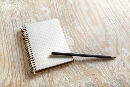 write a letter: Sketchbook with a pencil on light wooden background with soft shadows. Template for graphic designers portfolios and design presentations . Top view. Stock Photo