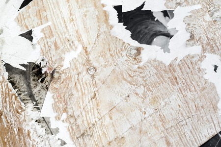 tattered: Old grungy wooden background with tattered paper. Stock Photo