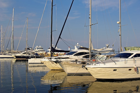 footstool: Beautiful white modern luxury yachts at seaport. Sunny summer day.