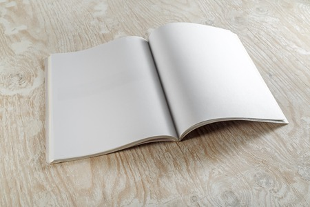 mockup: Blank booklet magazine on wooden background. Mockup for graphic designers portfolios.