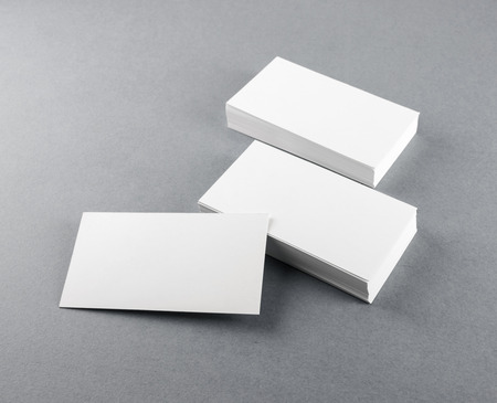 business card design: Photo of blank business cards with soft shadows on gray background. Template for branding identity. Stock Photo