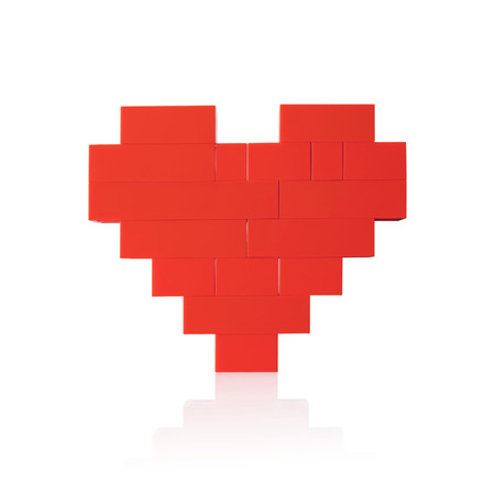 valentines gift: Heart made of red plastic blocks. Isolated on white background. Stock Photo
