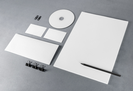 Photo of blank stationery set on gray background. Template for branding identity. For design presentations and portfolios.