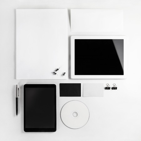 light background: Photo of blank stationery set on light background. Template for branding identity for designers. Top view.