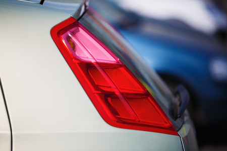 taillight: Closeup of a taillight on a modern car. Shallow depth of field. Selective focus. Stock Photo