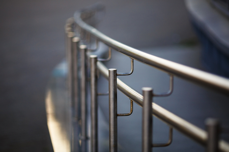 metal handrail: Chromium metal fence with handrail. Shallow depth of field. Selective focus. Stock Photo