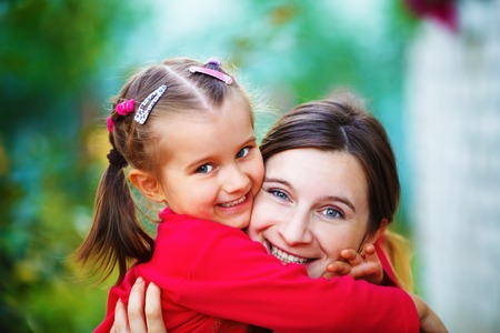 Embrace mother with  little daughter. Mom and child girl. Happy family. Shallow depth of field. Selective focus.