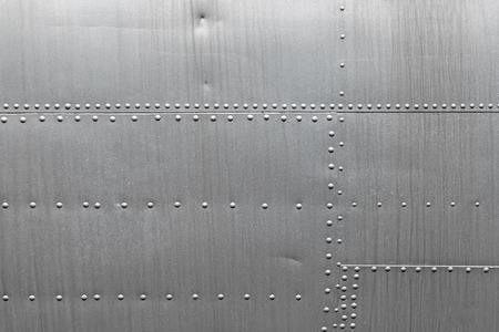 rivets: Abstract metallic background. Silver metal texture with rivets.