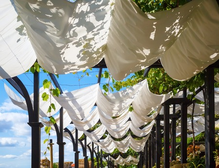 recreation area: White cloth canopy from the sun in a recreation area outdoor.