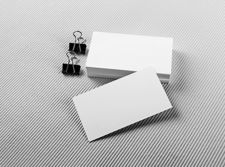 branding: Photo of blank business cards with soft shadows on gray background. For design presentations and portfolios. Mock-up for branding identity. Stock Photo